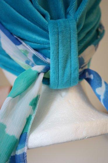 Stap 4: Maak de sjaal vast met een knoop.